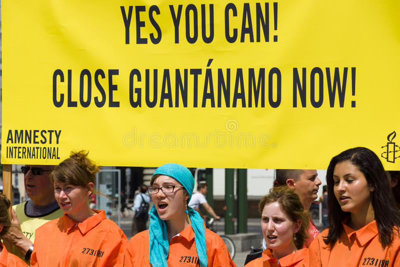 Amnesty International activists protest at Potsdamer Platz stock images