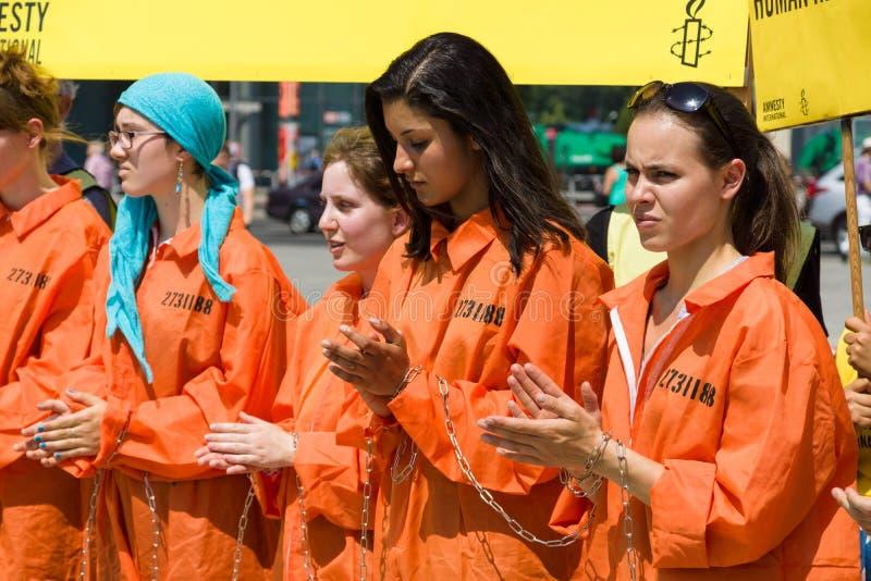 Amnesty International aktywistów protest przy Potsdamer Platz obraz stock