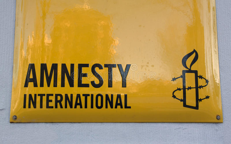 Amnesty international sign on a wall. Amsterdam, Netherlands-december 4, 2016: Amnesty international sign on a wall in amsterdam royalty free stock photo