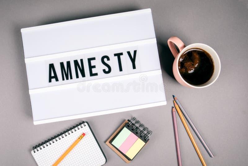 amnesty Texto na caixa leve imagem de stock royalty free