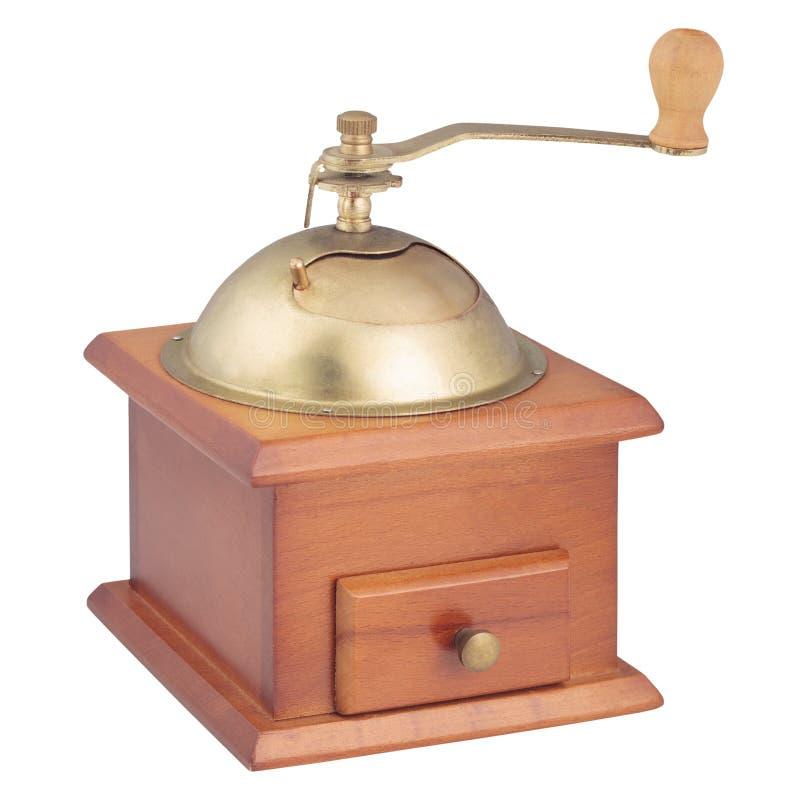 Amoladora de café de madera del vintage en blanco imagen de archivo