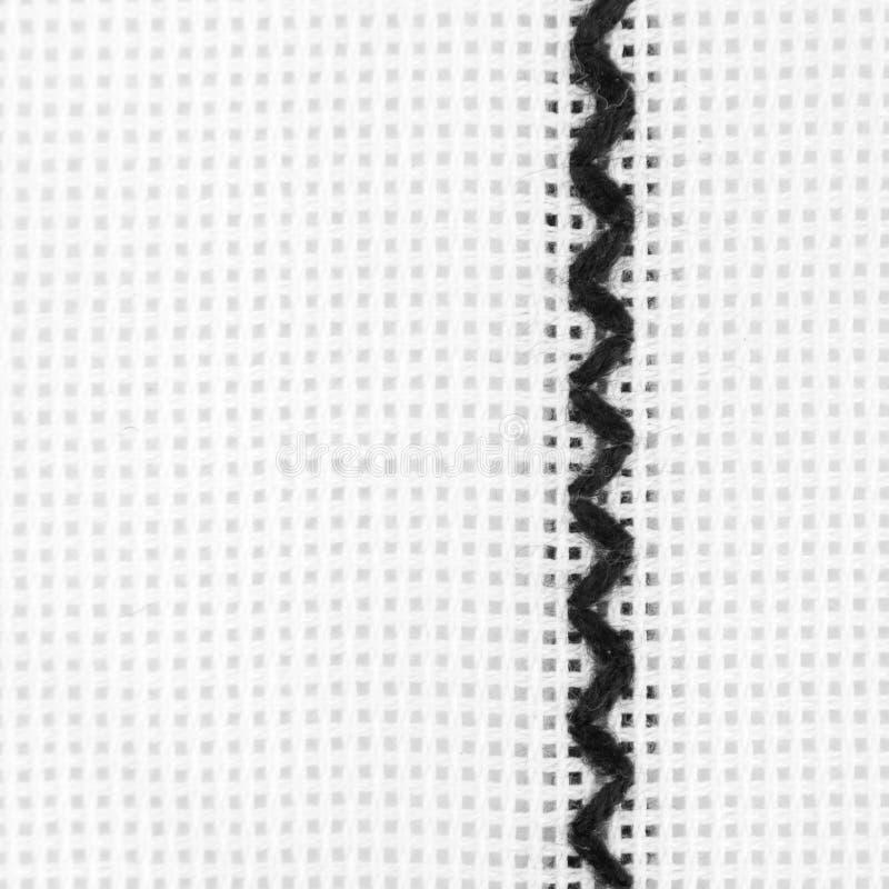 Amorçage noir sur le textile blanc photos libres de droits