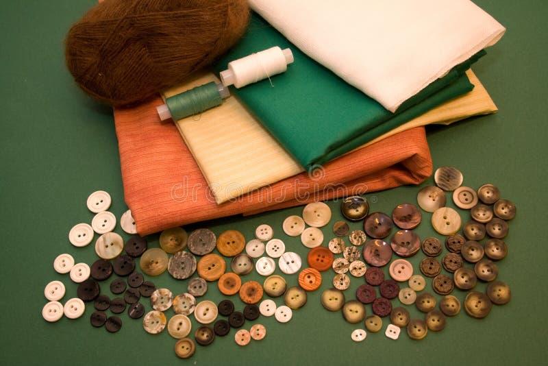 Amorçages, textile, boutons photographie stock