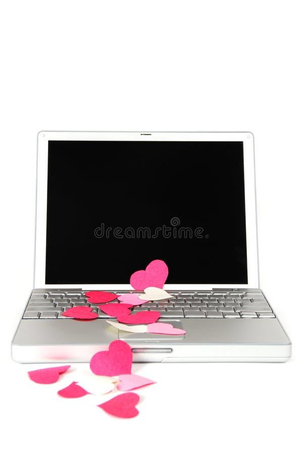 Amor 4 de la computadora portátil fotos de archivo