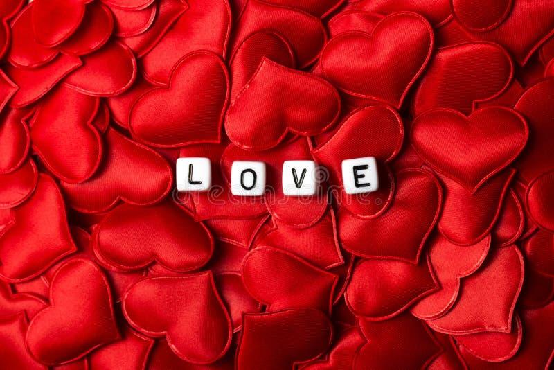 Amor datilografado com os dados em corações fotografia de stock royalty free