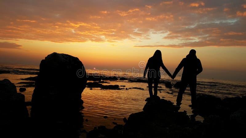 Amor de la puesta del sol imagenes de archivo