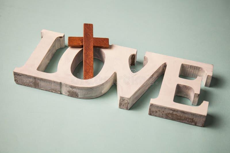 Amor dos deuses Cruz de madeira imagens de stock