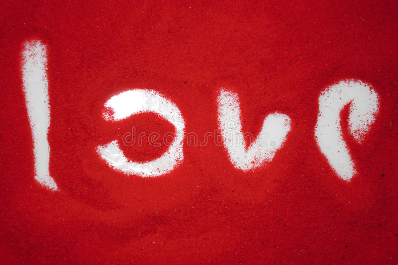 Amor en la arena roja foto de archivo