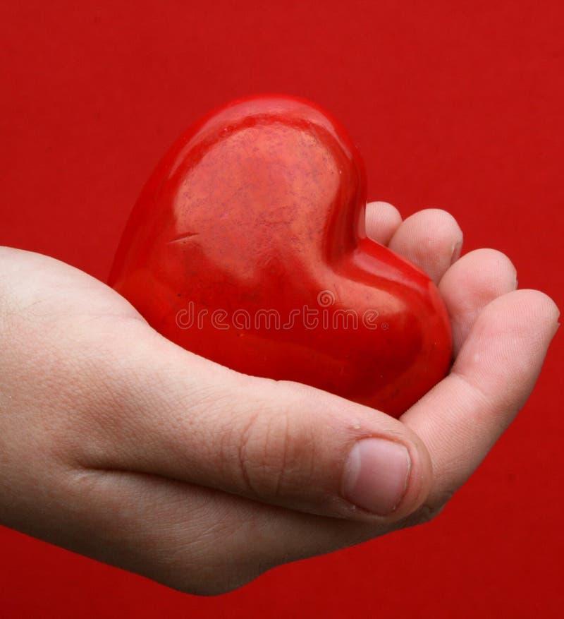 Amor en la mano foto de archivo libre de regalías