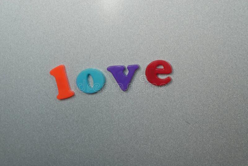 Amor magnético de las letras fotografía de archivo