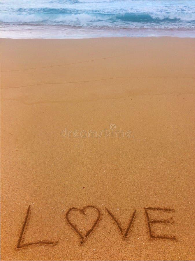 Amor na areia fotografia de stock royalty free