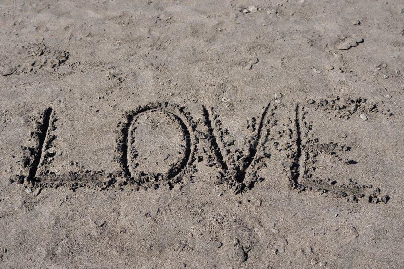 Amor na areia imagens de stock royalty free