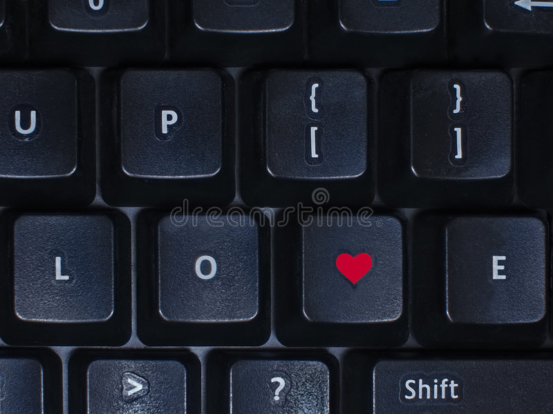 Amor no teclado fotografia de stock