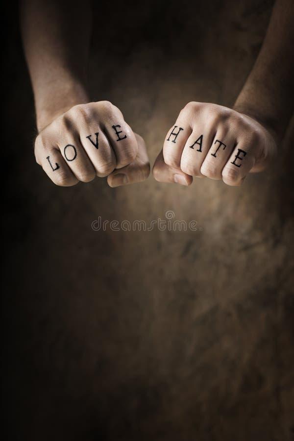 Amor u odio imagenes de archivo