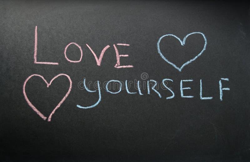 Amor você mesmo da inscrição fotografia de stock royalty free