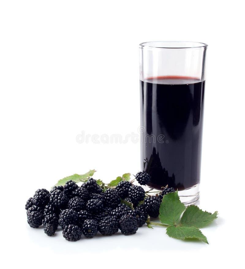 Amora-preta e vidro do suco fotografia de stock