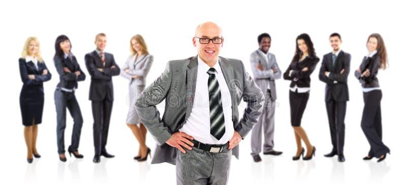 Amorce d'homme d'affaires restant devant son équipe photos libres de droits
