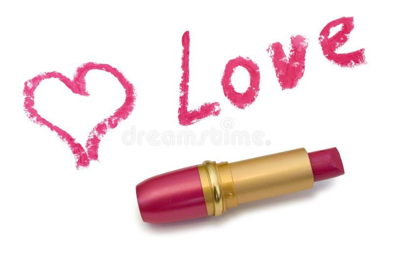 Amore, cuore e rossetto di parola fotografia stock