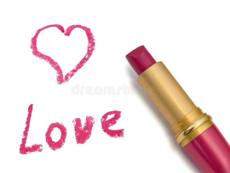 Amore, cuore e rossetto di parola fotografia stock libera da diritti