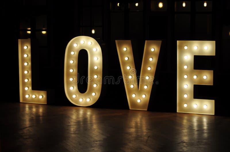 Amore decorativo delle luci della lettera fotografie stock