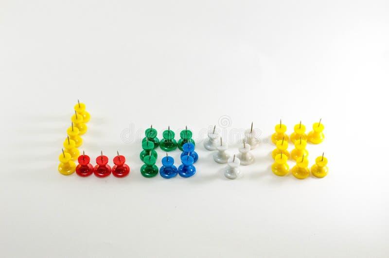 Amore di alfabeto dai perni con fondo bianco immagine stock libera da diritti