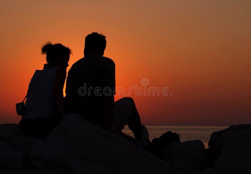 Amore e tramonto fotografie stock