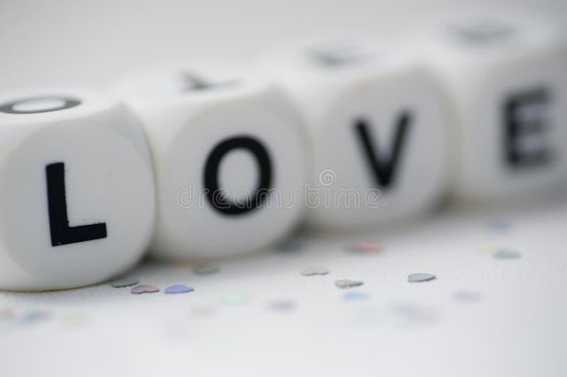 Amore, lettere dei dadi immagini stock libere da diritti