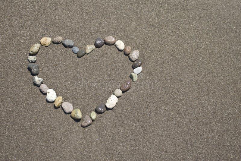 ?amore ' nella spiaggia sabbiosa fotografia stock libera da diritti