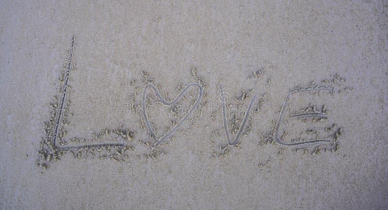 Amore sulla sabbia fotografia stock