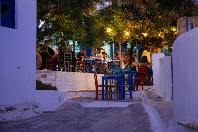 Amorgos, Greece-2 August 2017.People eating at a traditional Greek tavern in Lagada of Amorgos stock photos
