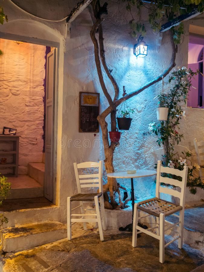Amorgos ,Greece-August 1,2017.A small cafe shop next to its cent stock photos