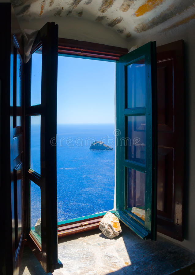 In Amorgos island in Greece. View to the sea from an open window of Hozoviotissa monastery in Amorgos island in Greece royalty free stock images