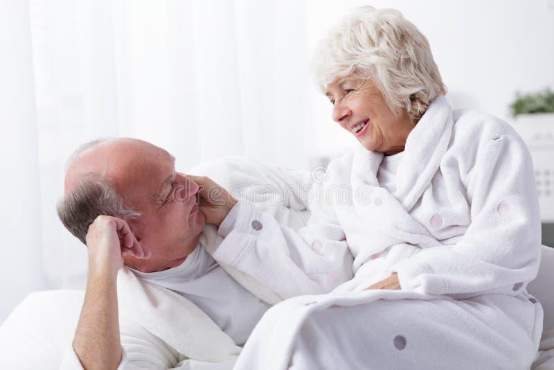 Amorous senior couple royalty free stock images