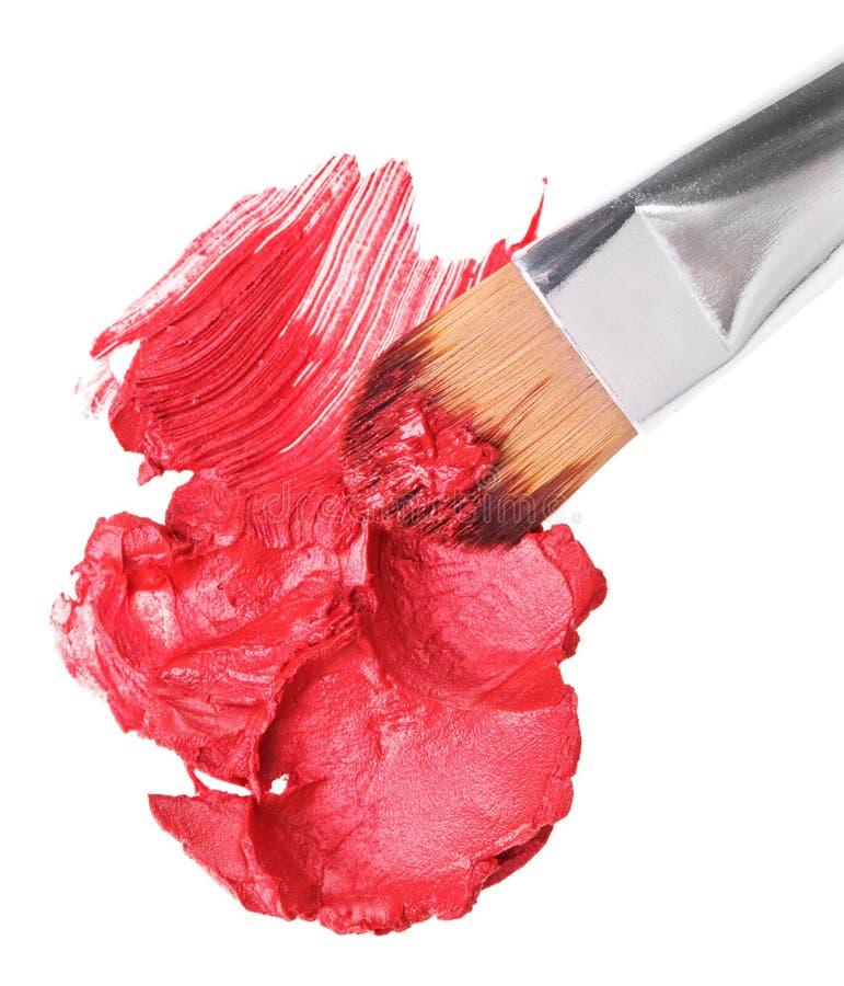 Amostra vermelha do batom com whit do brushon da composição imagem de stock royalty free