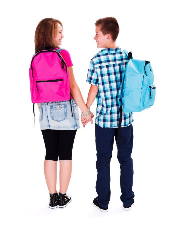 Amour adolescent - tenir des mains photographie stock libre de droits