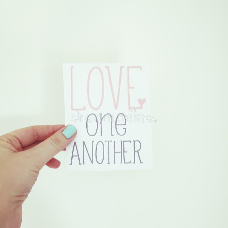 Amour dans des vos mains image stock