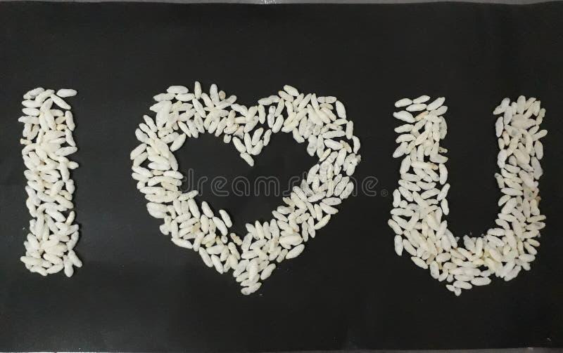 Amour soufflé u de ce dernier I de riz images stock