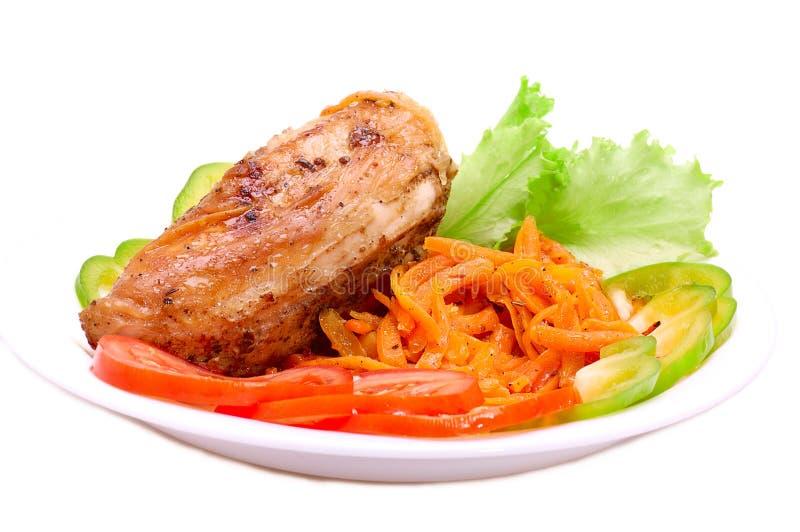 &vegetables rôtis de poulet photographie stock libre de droits