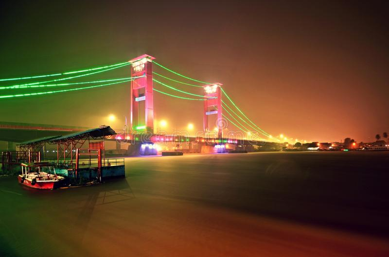 Ampera Bridge at Night, Palembang, Indonesia. Ampera bridge lighting green and pink at night. One of the most famous bridges in Indonesia royalty free stock photography