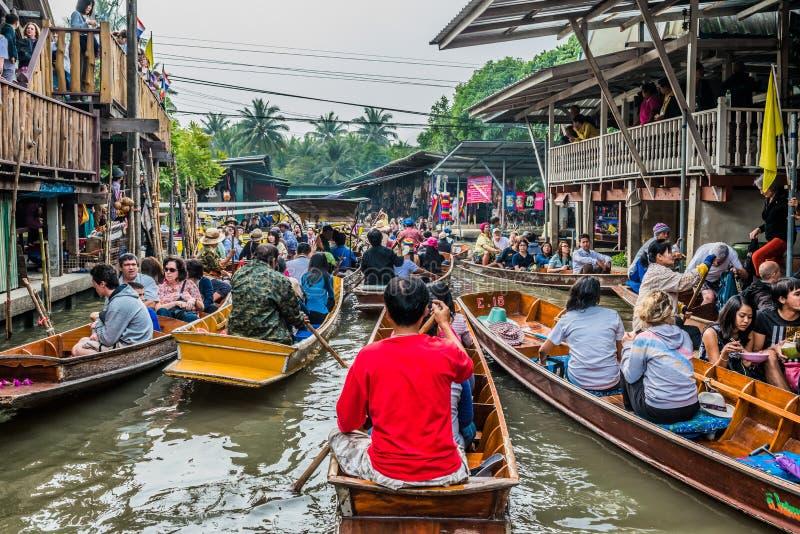 Amphawa bangkok floating market thailand. Bangkok, Thailand - December 30, 2013: people on boats at Amphawa Bangkok floating market at Bangkok, Thailand on royalty free stock images