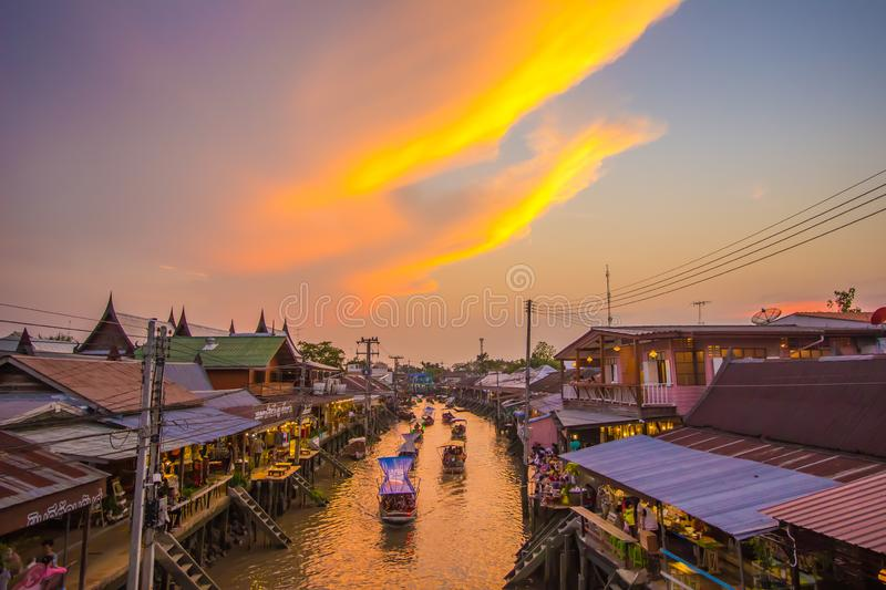 Amphawa district,Samut Songkhram Province,Thailand on April 12,2019:Amphawa Floating Market with beautiful sunset sky. Amphawa Floating Market is one of Thailand royalty free stock photos
