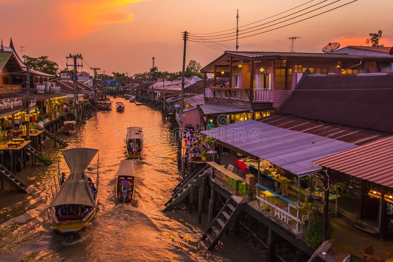 Amphawa district,Samut Songkhram Province,Thailand on April 12,2019:Amphawa Floating Market with beautiful sunset sky. Amphawa Floating Market is one of Thailand stock photo