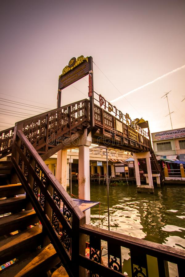 Amphawa district,Samut Songkhram Province,Thailand on April 13,2019:Wooden bridge across Amphawa canal at Amphawa Floating Market. Amphawa Floating Market is stock photo