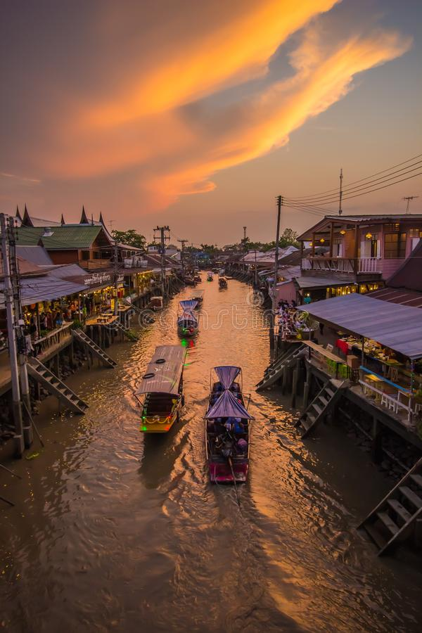 Amphawa district,Samut Songkhram Province,Thailand on April 12,2019:Amphawa Floating Market with beautiful sunset sky. Amphawa Floating Market is one of Thailand stock images