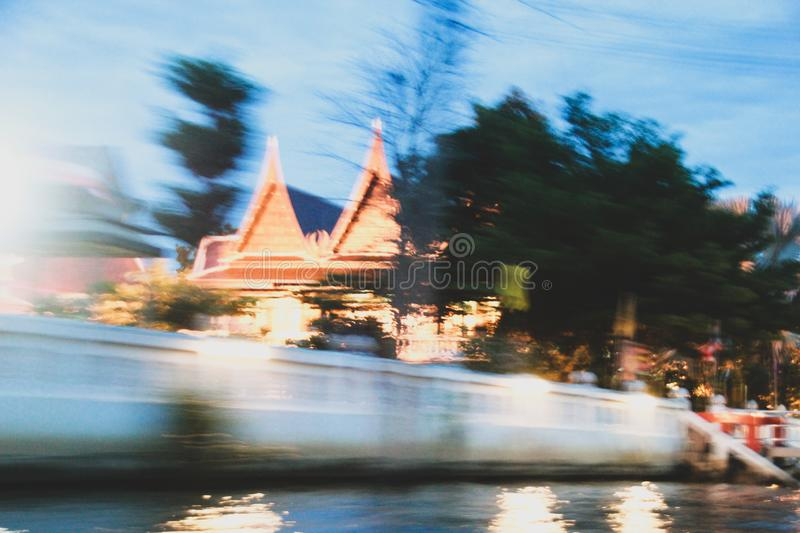 Amphawa speed temple market blurred. The temple near Amphawa flea market has been blurred. Because the boat runs at speed stock image
