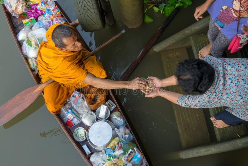 Monk Collecting Alms at Amphawa River royalty free stock photography