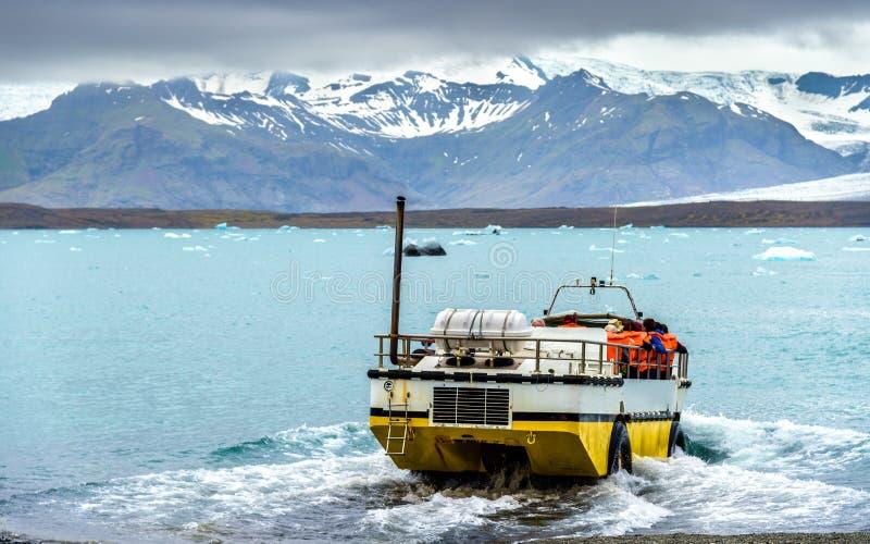 Amphibious vehicle in Jokulsarlon glacier lagoon - Iceland stock photography