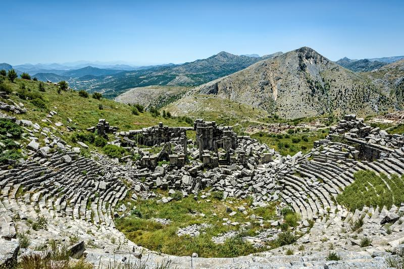 Amphitheater in ancient ruins high up in the mountains under cle royalty free stock image