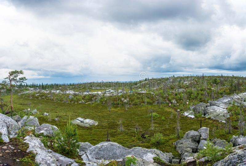 The amphitheater in the nature reserve of mount Vottovaara, Karelia. A natural amphitheater, which arose after a major earthquake in the reserve mount royalty free stock photo