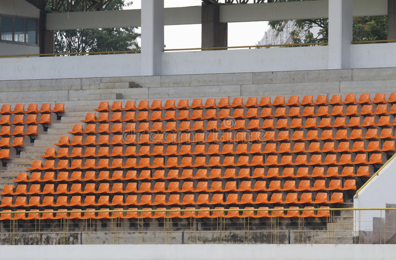 Amphitheater of orange seats in stadium abstract background royalty free stock images